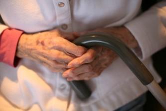 Senior  holding the cane