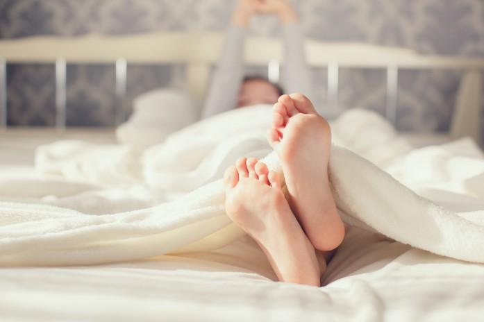 Baby foot in white blanket